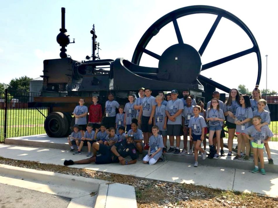 One of our student tours in front of the steam engine